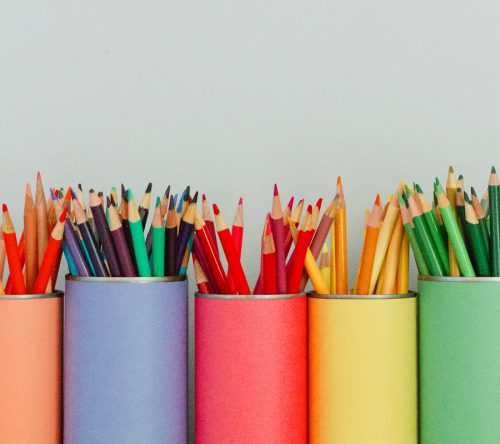 Bright Colored Pencils In Matching Containters