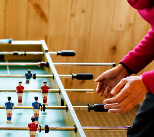 Mother And Child Playing Football Boardgame